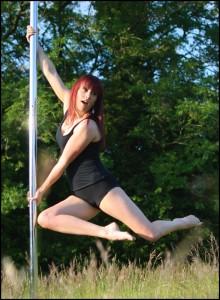 tabitha tease pole dance teacher for pink kitten doing a spin